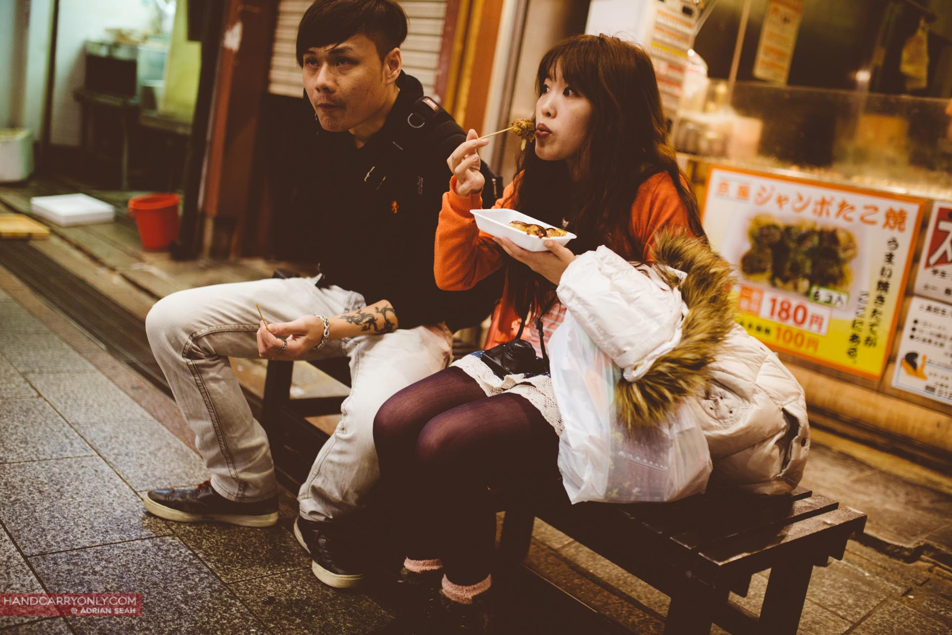 young couple eating tako yaki kyoto japan
