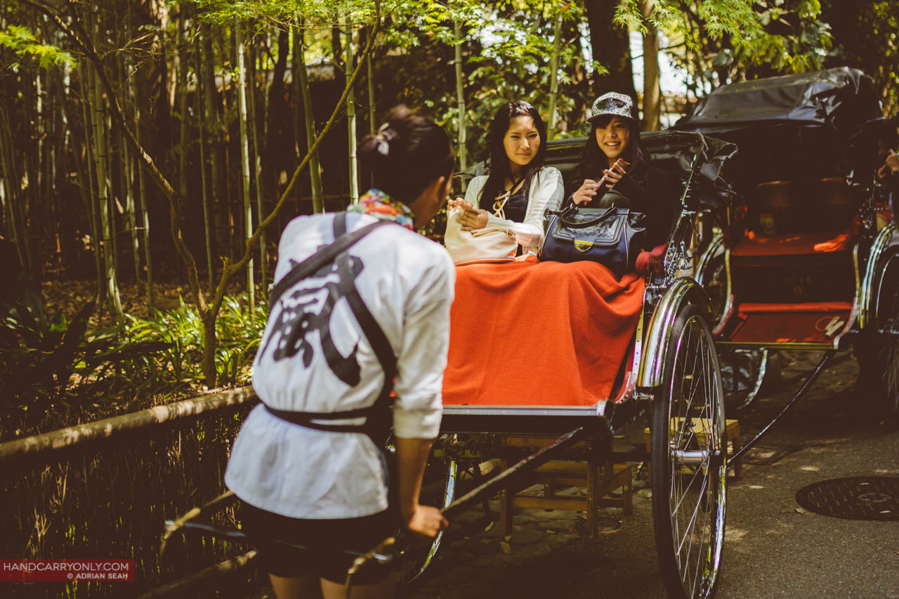 rickshaw with girls arashiyama kyoto japan