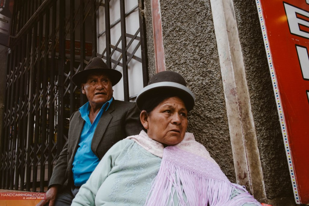 couple waiting for bus la paz bolivia