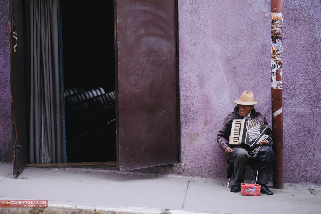 man playing accordion on the street la paz bolivia