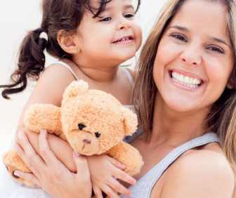 mom, and girl with teddy bear