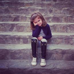 child sitting on stairs