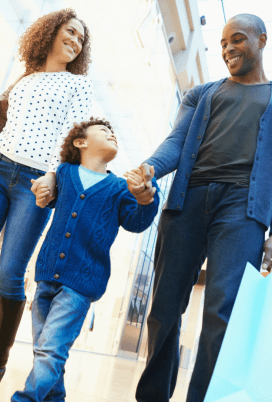 parents holding child's hand in post about consequences and punishments