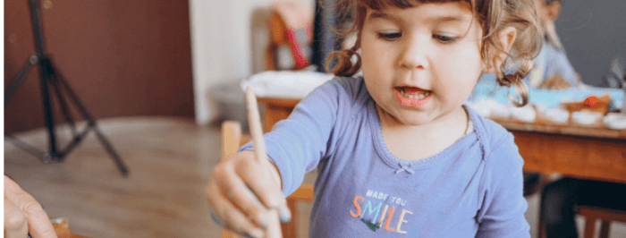 Child painting in homeschool