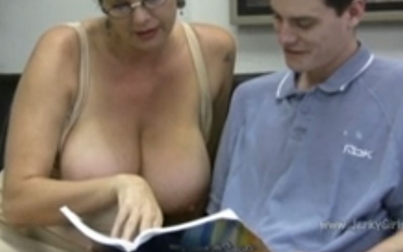 Busty Tutor gives him a handjob while he plays with her big tits