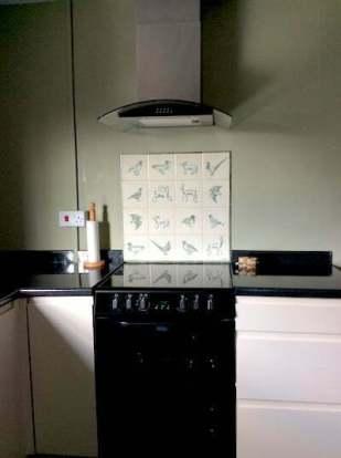 hand decorated cooker splash back