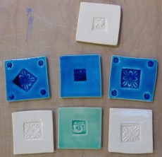 9cm. stamped handmade tiles. mixed.