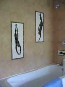 Divers inset tile panels for a bath, with client's plain tiles.