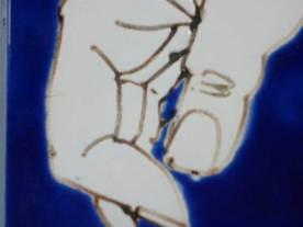 Hand tile with blue glaze