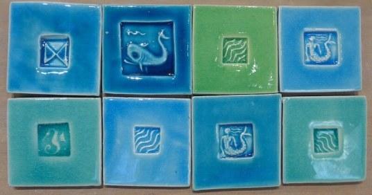 Stamped alkali glazed tiles