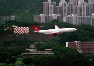 A Virgin Atlantic A340-300 passing the checkerboard for runway 13 at Kai Tak (c.1995)