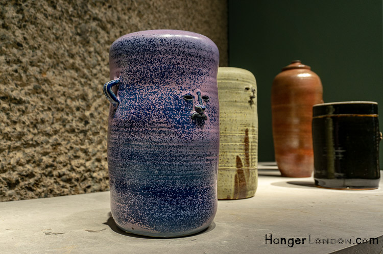 Curve Gallery Barbican Artist Francis Upritchard vase/ pots /urns /jars with cut out face detail