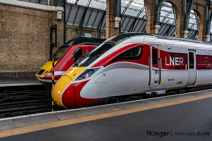 Yellow and Red nose of Azuma Train next to Intercity sitting at Kings Cross St Pancras Station