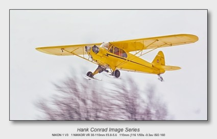 Nikon 1 V3 for Aviation   Piper Cub Flying in Snow
