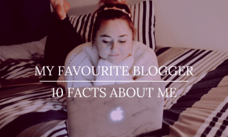 Hannah Gladwin sitting on a bed in front of a MacBook Pro - title image- Liebster Award-My-favourite-blogger and 10 facts abut me