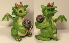 """Marble Dragon"" made of polymer clay, Swarovski crystals, and a dalmation rock marble"