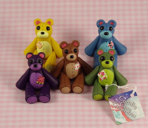 From top left: Lemon Bear, Blueberry Bear, Chocolate Bear, Grape Bear, Olive Bear all made of polymer clay.