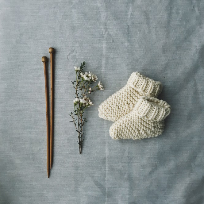 Image of tiny knitted baby booties