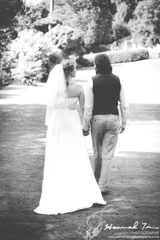 Bride & Groom walking black & white