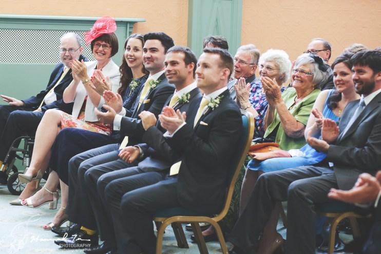 Wedding guests cheer