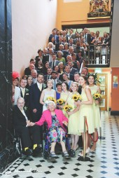 Whole wedding party on stairs