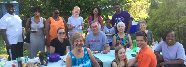 photo: people gathered around picnic table