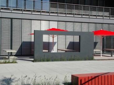 Durch das Fenster aus anthrazitfarbenen Sichtbeton kann man einen Blick auf die Terrasse wagen.