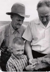 Bill, Billy, and Milton Hanson with fossil