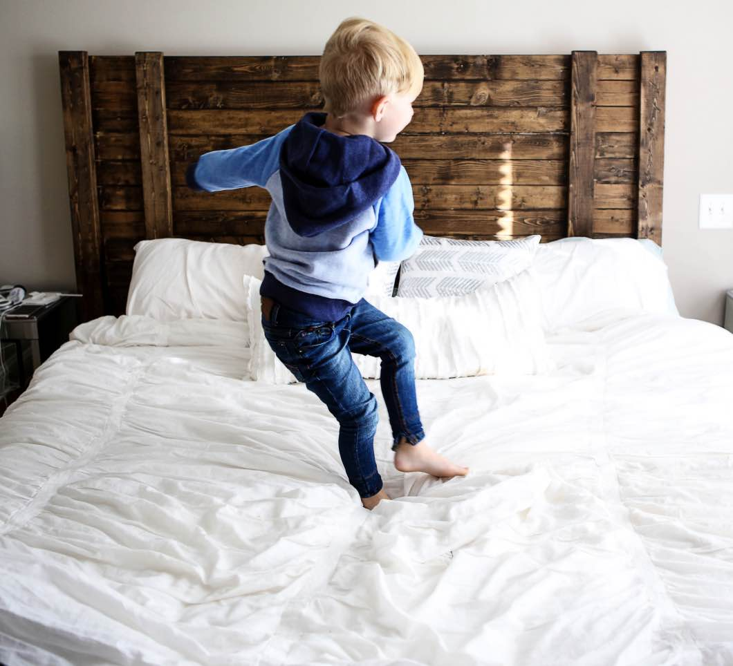 toddler jumping on the bed