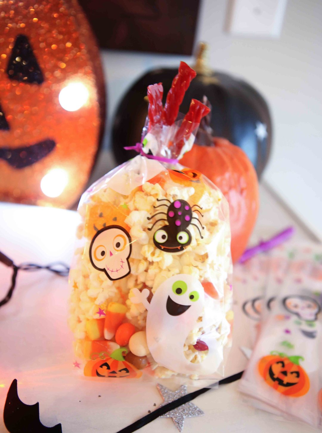 candy for popcorn bar - Halloween Popcorn Bar by Atlanta lifestyle blogger Happily Hughes
