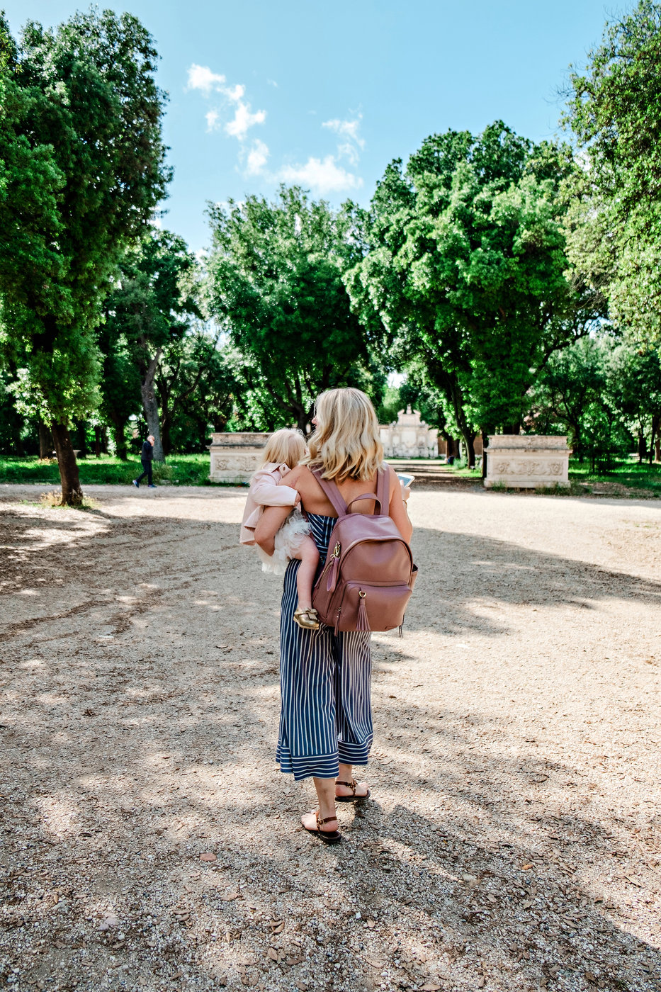 The Ultimate Packing List for your International Travel with Kids featured by popular Atlanta travel blogger Happily Hughes