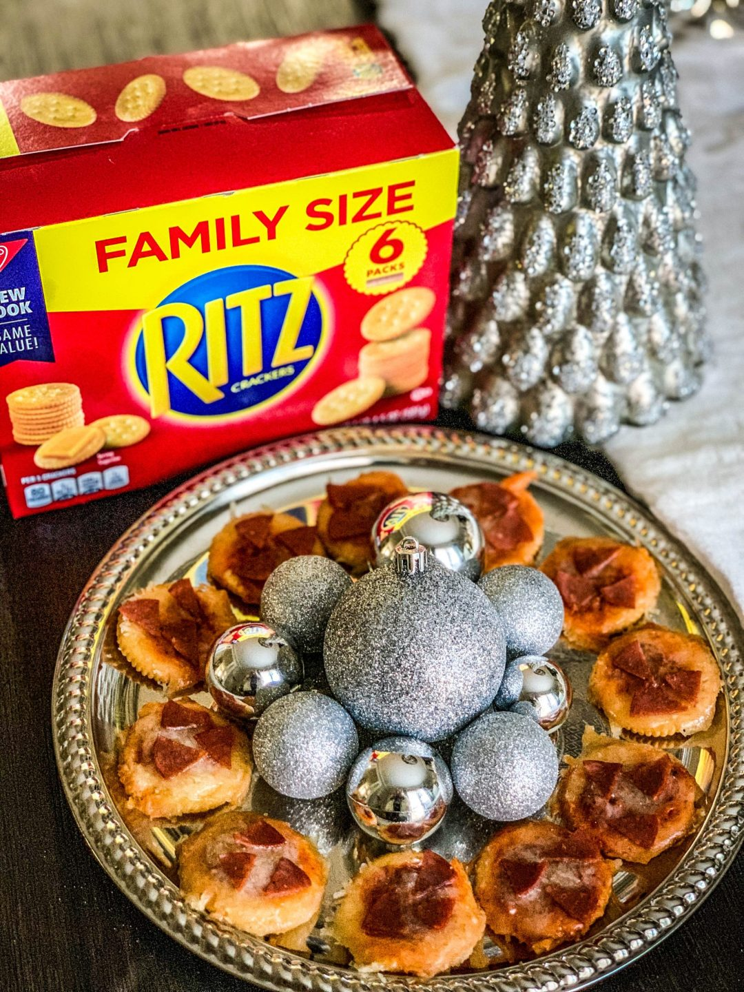 Looking for the perfect holiday appetizer? Popular Atlanta Blogger Happily Hughes is sharing her go to holiday treat- Christmas Wreath Pizzas. Click to see them HERE!
