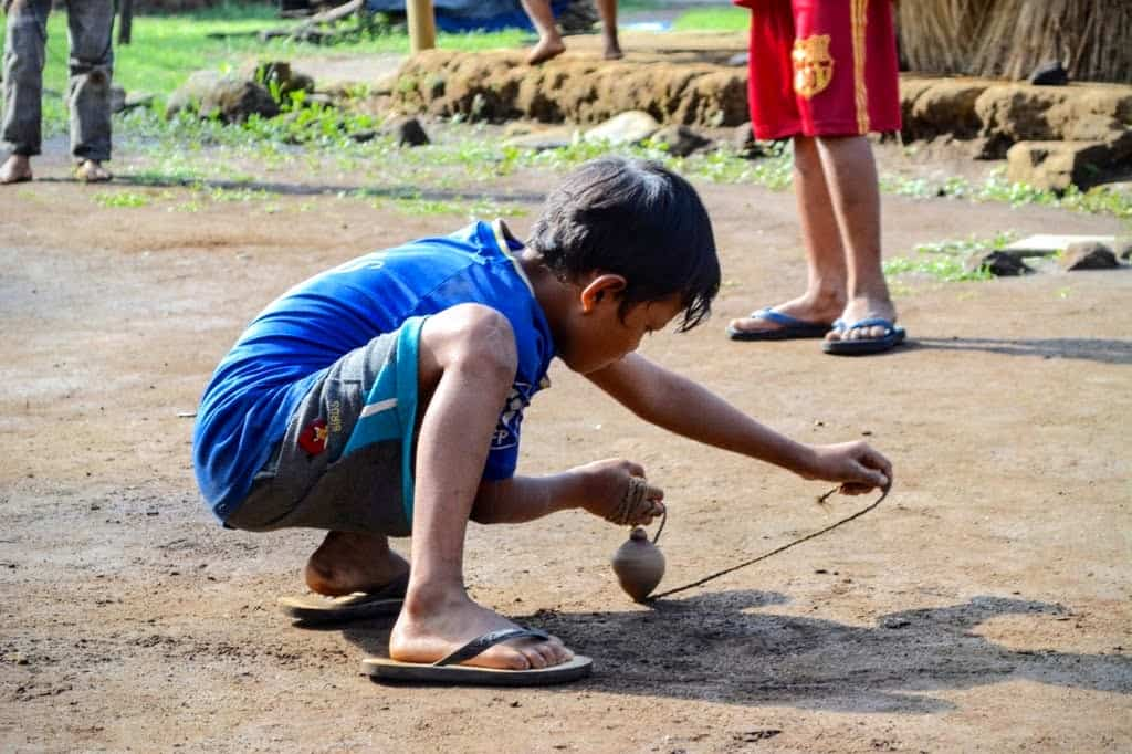 Kids playing a traditional game