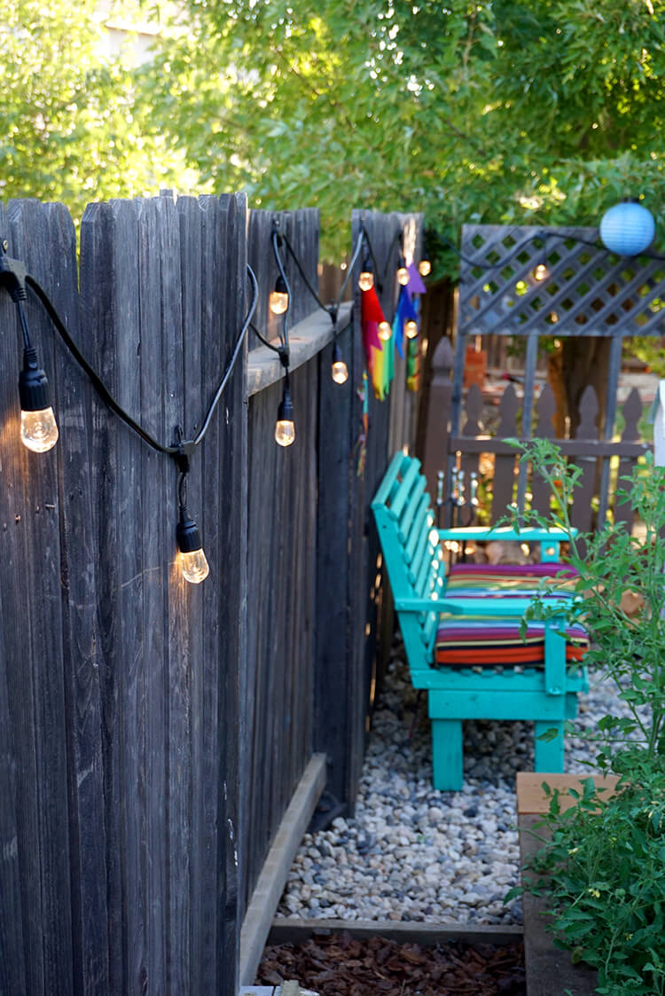 Enbrighten Cafe String Lights along the Garden Fence