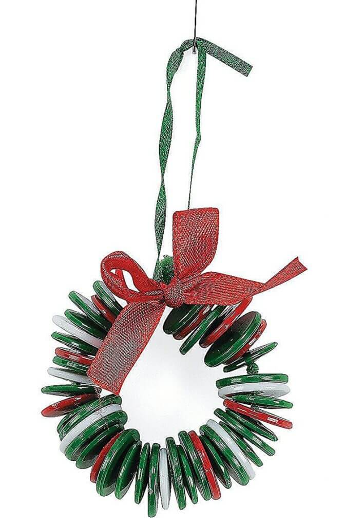 Christmas crafts for kids: button wreath Christmas ornament with red ribbon on white background