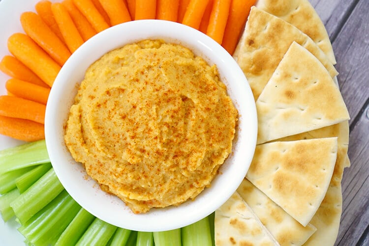 This healthy roasted red pepper and red lentil hummus is packed full of flavor, and it's super quick and easy to make! Makes a great party appetizer or healthy after school snack!