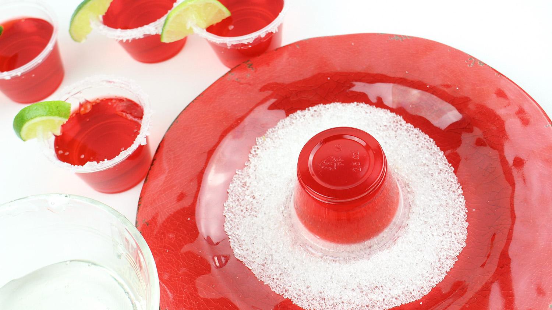 rimming a jello shot glass with coarse sugar