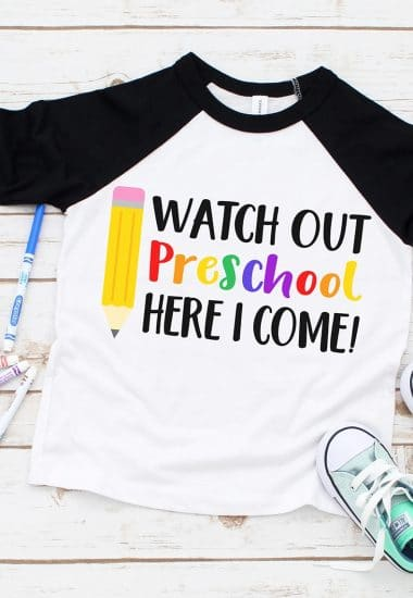 """""""Watch Out Preschool Here I Come"""" SVG on black raglan shirt surrounded by colorful markers and kids shoes"""
