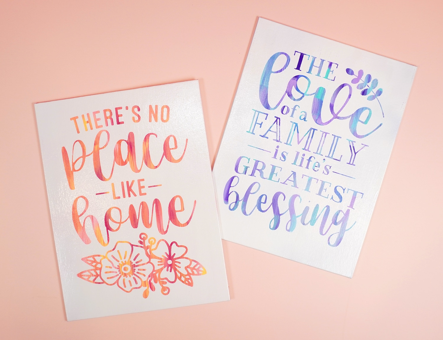 """Two hot mess canvases with """"There's No Place Like Home"""" and """"The Love of a Family is Life's Greatest Blessing"""" quotes"""