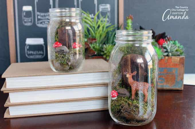 Fairy garden in a mason jar with deer and red polka dot mushrooms
