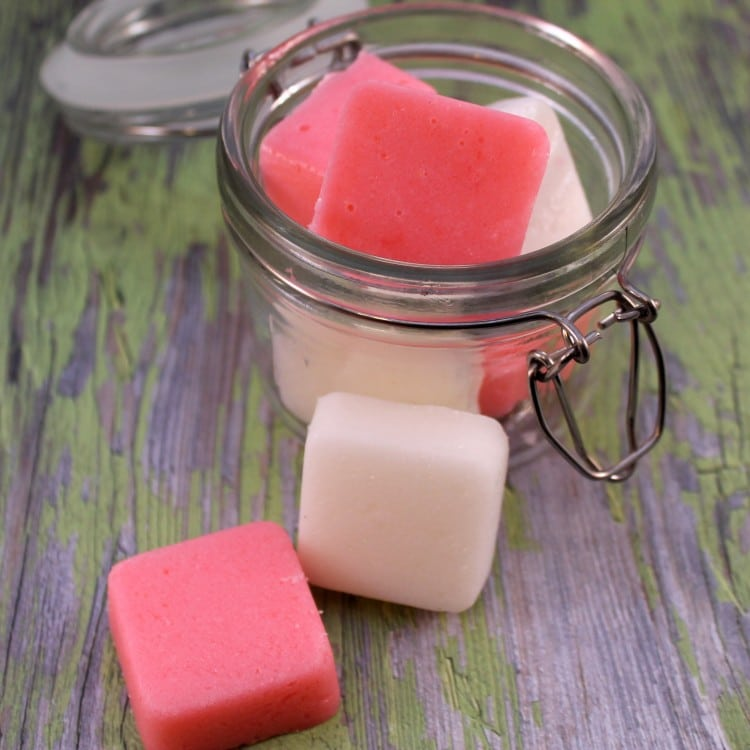 Glass jar with red and white peppermint sugar scrub bars