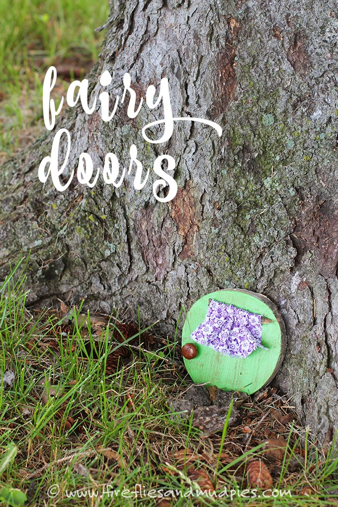 Fairy garden door made from round piece of wood painted mint green with purple flower printed cloth window covering