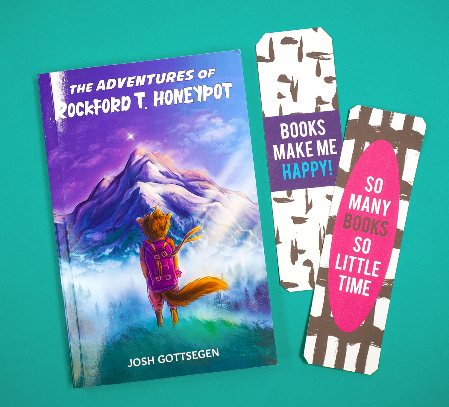 ""\""""The Adventures of Rockford T. Honeypot"""" book and printable bookmarks on teal background""1500|1359|?|en|2|453f33d384fc7f6e250c7c354b5052c9|False|UNLIKELY|0.34204283356666565