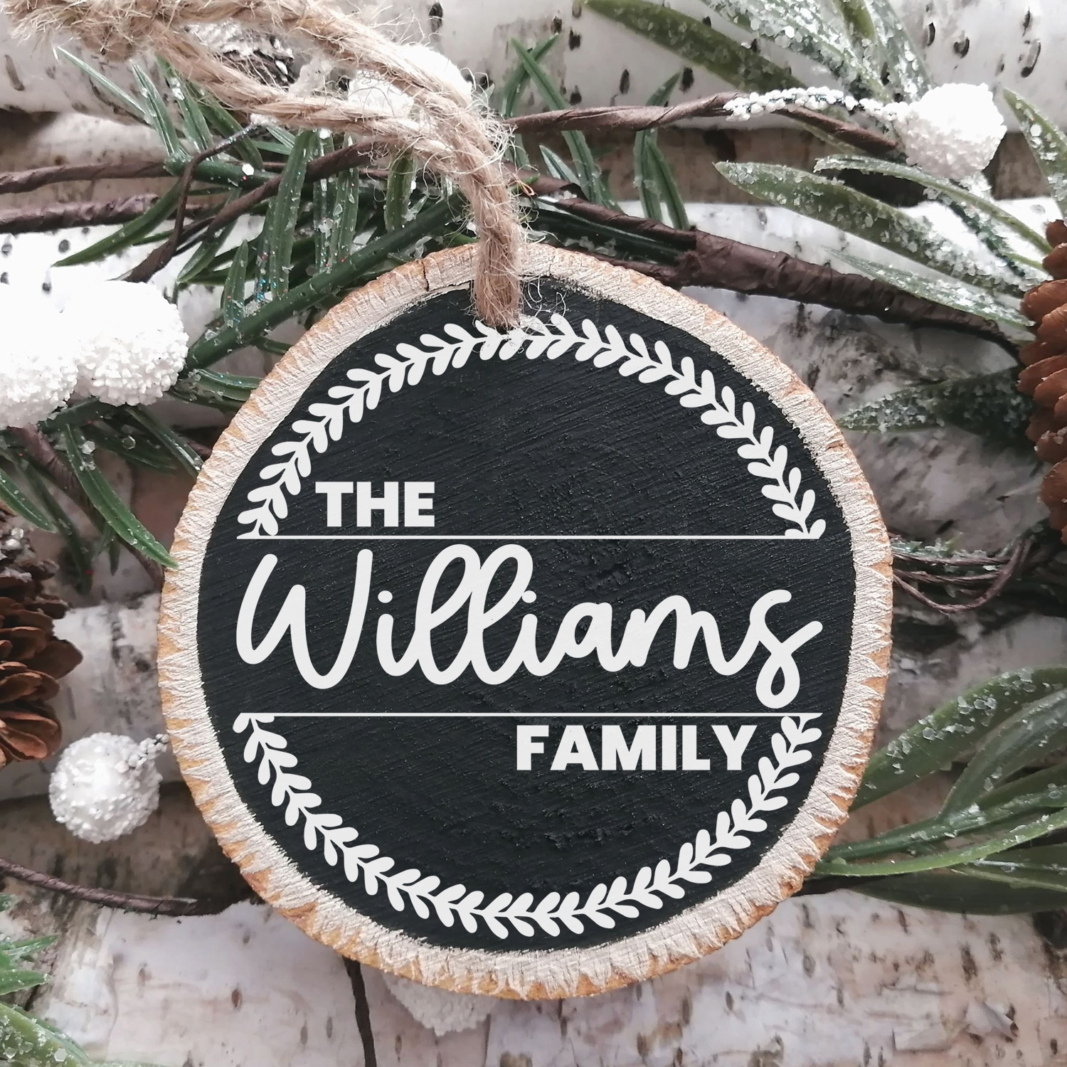 """Chalkboard painted wood slice Christmas ornament with """"The Williams Family"""" and wreath design"""