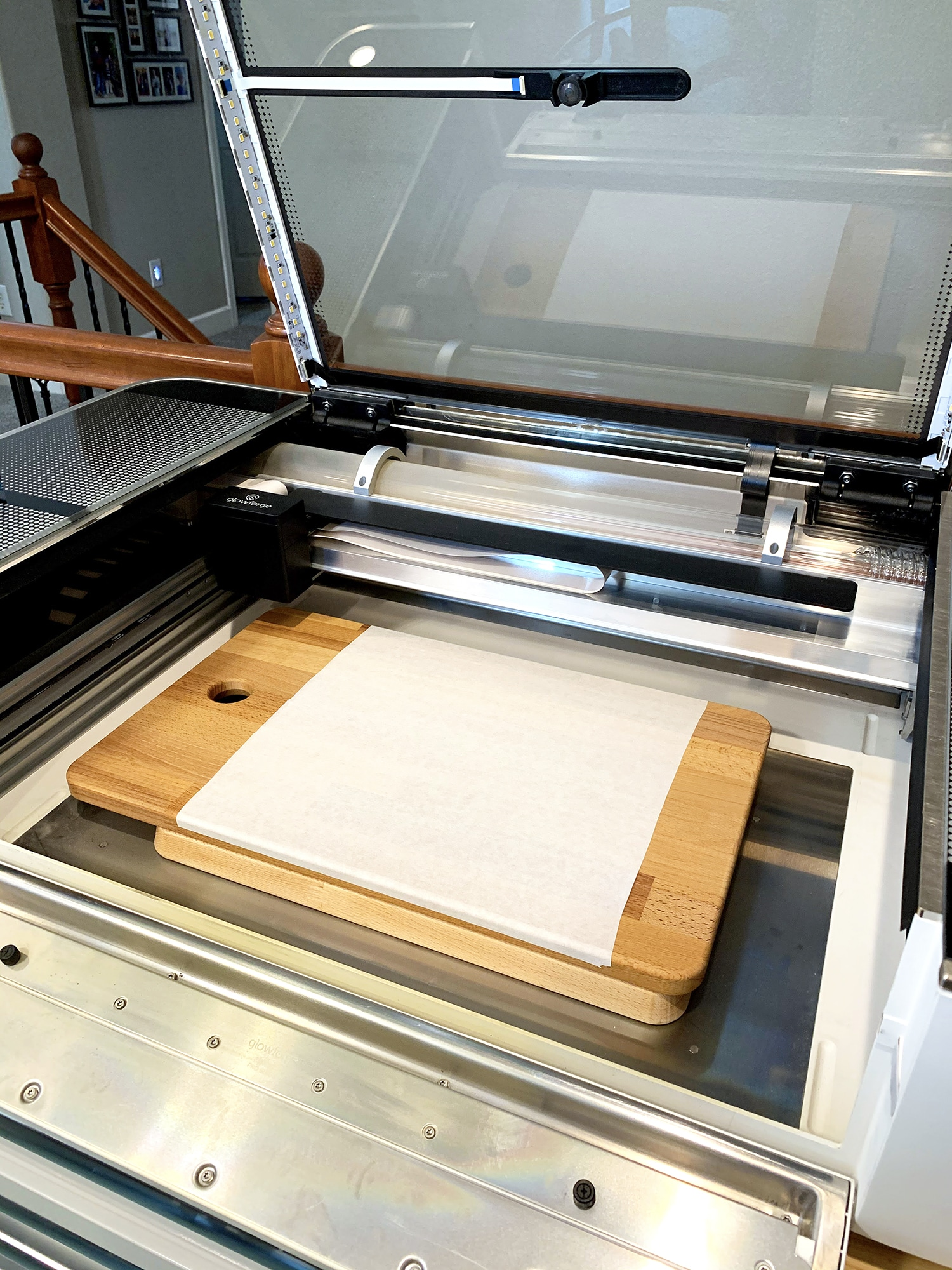 Open Glowforge Machine with Masked Cutting Board and Side Lowered