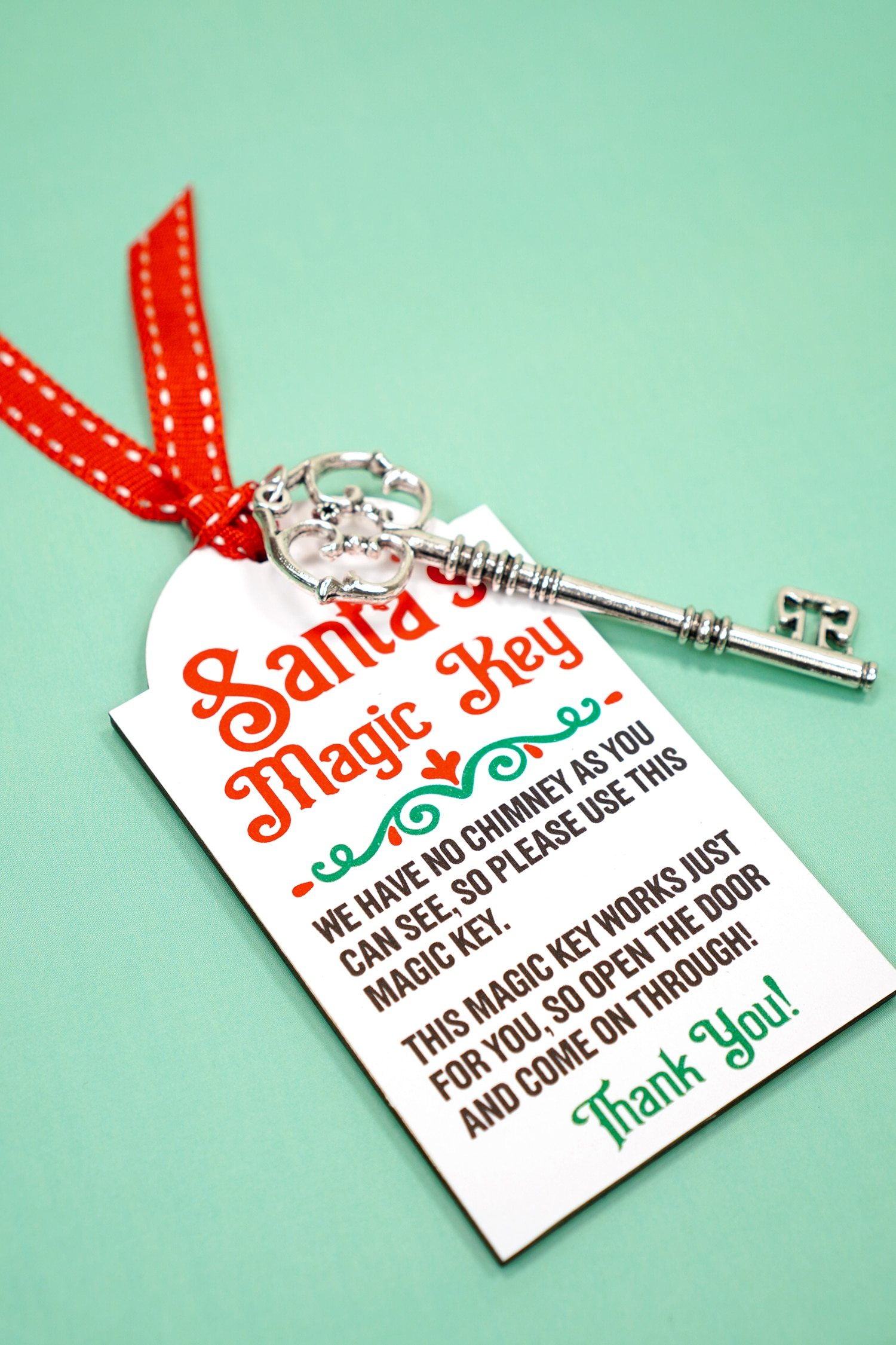 Printable Santa's Magic Key with red ribbon and silver key on mint green background