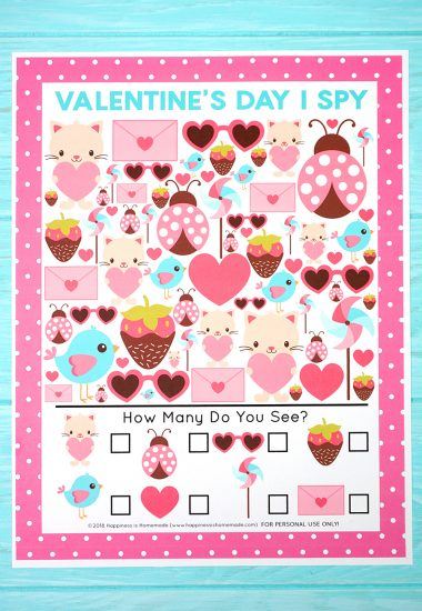 Valentine's Day I Spy Game on blue wood background