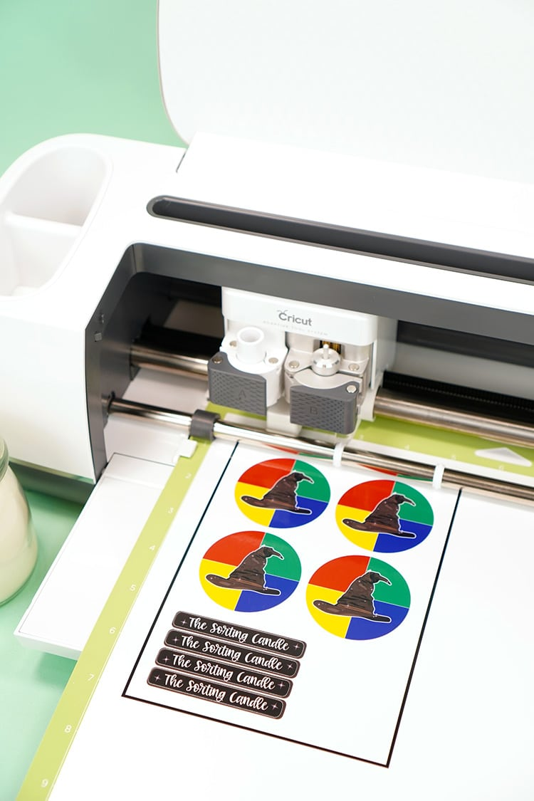 "Cricut Maker machine cutting ""The Sorting Candle"" labels with Print Then Cut"