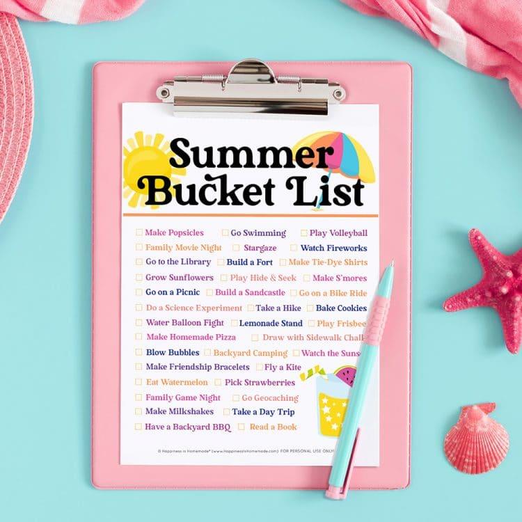 Summer bucket list printable on pink clipboard and aqua background