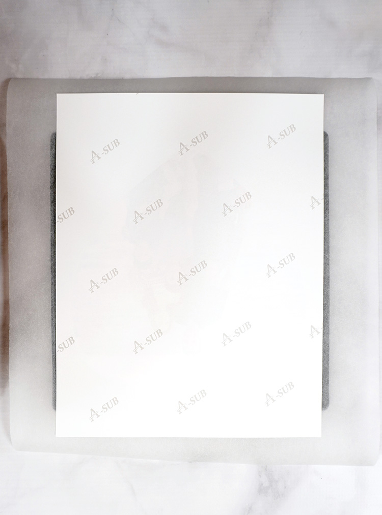 Sheet of A-Sub sublimation paper over puzzle on heat resistant mat